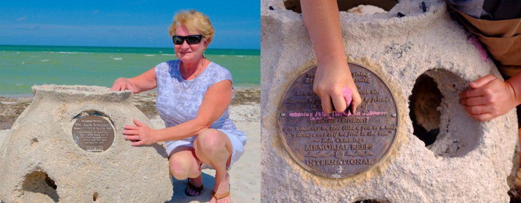 family member beside reef memorial